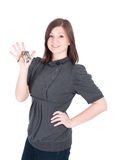 Young beautiful woman showing apartment keys on white background Royalty Free Stock Photography