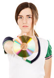 Young beautiful woman showing a CD Royalty Free Stock Image