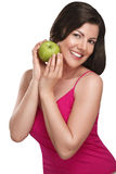 Young beautiful woman showing fresh fruits of season Royalty Free Stock Photo