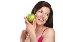 Young beautiful woman showing fresh fruits of season Stock Photos
