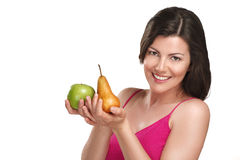 Young beautiful woman showing fresh fruits of season Stock Images