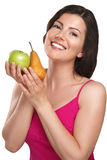 Young beautiful woman showing fresh fruits of season Royalty Free Stock Photos