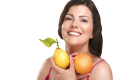 Young beautiful woman showing fresh fruits of season Stock Photos