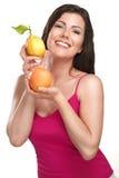 Young beautiful woman showing fresh fruits of season Royalty Free Stock Photography