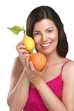 Young beautiful woman showing fresh fruits of season Stock Photo
