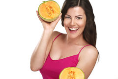 Young beautiful woman showing fresh fruits of season Royalty Free Stock Images