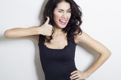 Young beautiful woman showing hand ok sign Royalty Free Stock Image