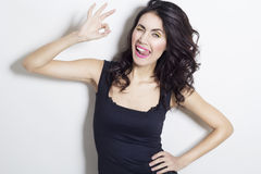 Young beautiful woman showing hand ok sign Royalty Free Stock Photo