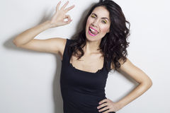 Young beautiful woman showing hand ok sign Stock Images