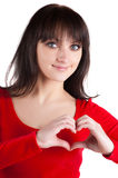 Young beautiful woman showing heart symbol. Stock Photography
