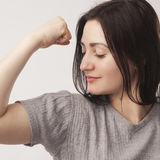 Young beautiful woman showing her beautiful arms as a symbol of Stock Image