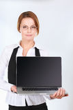 Young beautiful woman showing a laptop, isolated on white background.  Royalty Free Stock Photo