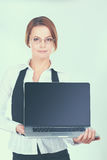 Young beautiful woman showing a laptop, isolated on white background.  Royalty Free Stock Image