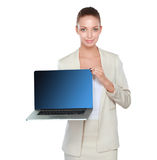 Young beautiful woman showing a laptop, isolated on white background.  Royalty Free Stock Images