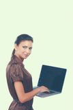 Young beautiful woman showing a laptop,  on white background.  Stock Images