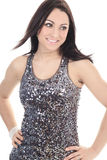Young beautiful woman in silver dress posing at Royalty Free Stock Images