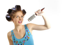 Young beautiful woman singing to brush microphone Royalty Free Stock Photos