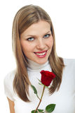 Young beautiful woman with a single red rose Stock Photography
