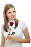 Young beautiful woman with a single red rose Royalty Free Stock Images