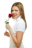 Young beautiful woman with a single red rose Stock Photo