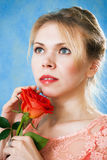Young beautiful woman with a single red rose Stock Images