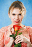 Young beautiful woman with a single red rose Royalty Free Stock Photography
