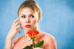 Young beautiful woman with a single red rose Royalty Free Stock Image