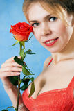 Young beautiful woman with a single red rose Royalty Free Stock Photo