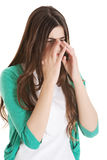 Young beautiful woman with sinus pressure, touching her nose. Stock Images