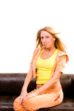 Young beautiful woman sit on sofa Royalty Free Stock Photos