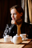 Young beautiful woman sits in cafe Stock Photo