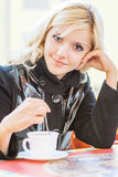 Young beautiful woman sits in cafe Royalty Free Stock Photography
