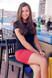 Young beautiful woman sitting at bar counter Royalty Free Stock Photos