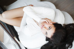 Young beautiful woman sitting on couch at her room Stock Image
