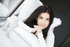 Young beautiful woman sitting on couch at her room Stock Photography