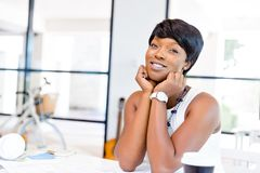 Young woman sitting at a desk in an office and working on blueprint Stock Photography