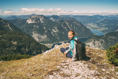 Young beautiful woman sitting on the edge of mountain Royalty Free Stock Images