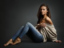 Young beautiful woman sitting on floor Stock Photo