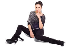 Young beautiful  woman. Sitting on the floor Stock Images