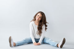 Young beautiful woman sitting on floor Royalty Free Stock Photos