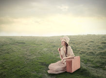 Young beautiful woman sitting on the grass royalty free stock photos