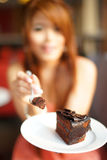 Young Beautiful Woman Sitting In Cafe Eating Chocolate Cake Royalty Free Stock Photography