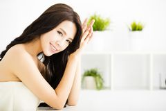 Young beautiful woman sitting in  living room Stock Photos