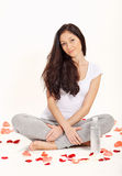 Young beautiful woman sitting in lotus pose Royalty Free Stock Photo