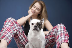Young beautiful woman sitting with pug dog Stock Photo