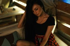 Young beautiful woman sitting on a sofa in the bar. royalty free stock photography