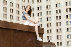 Young, beautiful woman sitting on stairs, near the university. Young, beautiful woman sitting on stairs near the university Stock Photos