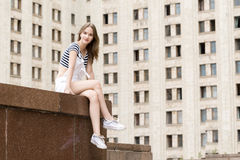 Young beautiful woman sitting on stairs near the university Stock Photos