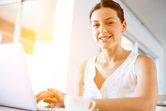 Young beautiful woman working on her laptop Stock Images