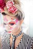 Young beautiful woman with skull makeup. Mexican day of the dead. Art in the style of sugar skulls royalty free stock photos